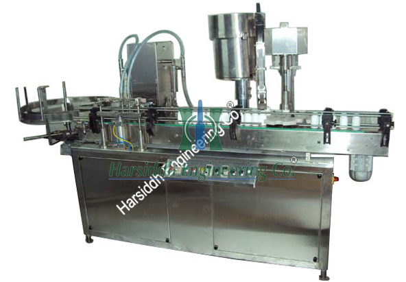 Liquid Bottle Filling And Capping Machine (Monoblock)